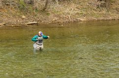 Fisherman Releasing a Trout Back into the Roanoke River, Virginia, USA - 2 Royalty Free Stock Photo