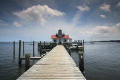 Roanoke Marshes Lighthouse Manteo NC. The Roanoke Marshes Lighthouse on Manteo NC waterfront is an example of a screw-pile lighthouse and is an active aid to Stock Photography
