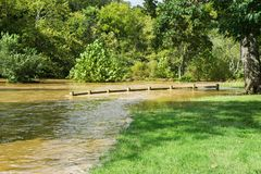 Roanoke River Greenway Underwater, Roanoke, Virginia, USA. Sept. 8th, 2018 View of the Roanoke River Greenway located in Wasena Park underwater from the Roanoke stock images