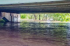 Roanoke River High Water under a Bridge - Hurricane Florence in 2018. Roanoke, VA – Sept. 8th: The rising Roanoke River under a bridge covering the royalty free stock images