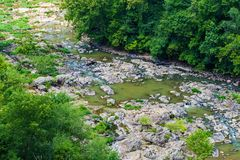 Low Water Level of the Roanoke River. Roanoke River seasonal low water level from the lack of rainfall located in the Blue Ridge Mountains of Virginia, USA stock images