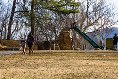 Families Playing in a Park. Roanoke VA – February 2nd, 2019: Families enjoy a warm winter day at Mill Mountain Park located on Mill Mountain, Roanoke royalty free stock photos