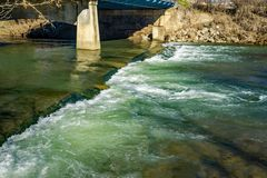 High Water Over the Roanoke River Dam. Roanoke, VA – January 7th: High water over the Roanoke River dam next to Wiley Drive on the Roanoke River Greenway royalty free stock photos