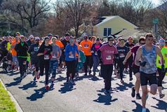 Pets, Walkers, Runners for the Annual Roanoke Valley SPCA 5K Tail Chaser. Roanoke, VA – March 23rd: A large of group of runners, walkers and their pet stock image