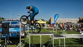 BMX Stunt Show. Roanoke, VA – October 13th: A rider performing BMX stunt at the annual GO Outside Festival at the River's Edge Park located in stock photography
