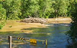 Raging Roanoke River. Roanoke, VA – Sept. 8th: View of the raging Roanoke River at the low bridge and a tall pile of debris located on the Roanoke River royalty free stock image