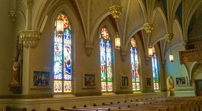 Beautiful interior of Saint Andrew`s Catholic Church. Roanoke, VA, May 25th: Marble alter in the beautiful Saint Andrew`s Catholic Church located in Roanoke royalty free stock photos