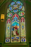 Beautiful Stain Glass Window at Saint Andrew`s Catholic Church. Roanoke, VA, May 25th: The view of a large stain glass window to Saint Andrew located in the royalty free stock photo