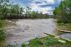 Roanoke River Above Flood Stage. Roanoke, Virginia, April 16th: A view of the Roanoke River at flood stage located in Wasena Park, Roanoke, Virginia, USA on royalty free stock image
