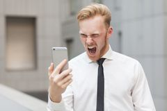 Roar. Funny worker looking at screen and shout. Close up royalty free stock photo