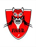 Roaring Tiger Head mascot. Roaring angry Tiger Head Over the Red Shield Stock Photos