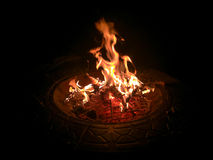 Roaring Camp Fire. A camp fire burns on a very dark evening royalty free stock photo
