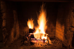 Lovely roaring fire in a rustic fireplace Royalty Free Stock Image