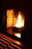 Roaring Fire. A wood burning fire in a darkened room Stock Images
