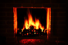 Roaring Fire. A warm roaring fire in a brick fire place Stock Image