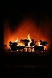 Roaring Fire. A huge fire burns warmly in a brick fireplace Stock Photo