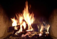 Roaring fire in the fireplace Royalty Free Stock Photos