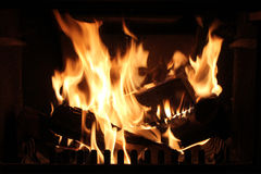 Roaring fire in a fireplace. Stock Photo