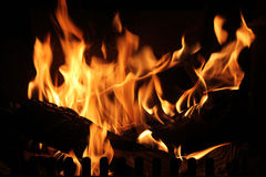 Roaring fire in a fireplace. Stock Images