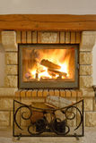 Roaring flames in  fireplace Royalty Free Stock Images