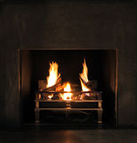 Roaring flames in a modern fireplace Stock Photos