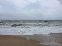 Roaring and foamy sea waves at Kundapura beach. Roaring and foamy sea waves at the beaches of Kundapura Stock Images