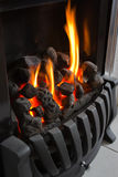 Roaring home fireplace in winter Stock Images