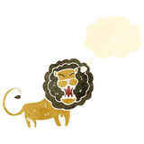 Roaring lion with thought bubble retro cartoon Stock Photo