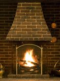 Roaring log fire of old English house. With brickwork surround Royalty Free Stock Images