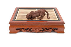 Roaring tiger figurine on chinese wooden table Royalty Free Stock Image