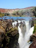 Namibia, Epupa, Breathtaking Waterfall View with Palm Trees royalty free stock photography