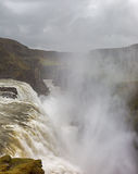 Roaring waterfall in Iceland. Stock Photography