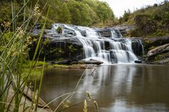 Big waterfall outside of Clemson, SC. Roaring waters of a waterfall pile over the rocks Stock Images