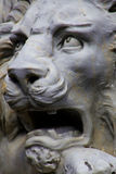 Roaring White Lion Statue. Closeup of White Lion sculpture showing lions face roaring with eyes looking upwards Stock Photo
