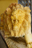 Roaring yellow lion statue. Crafts factory, Northern Vietnam Royalty Free Stock Images