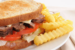 Roasst beef sandwich and fries Stock Photo