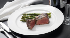 Roast. Chopped steak with asparagus and grilled vegetables Stock Image