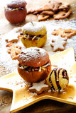 Roast apple with cinnamon stars on Christmas plate Royalty Free Stock Image