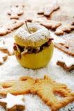 Roast apple with cinnamon stars and spekulatius cookies Royalty Free Stock Photography