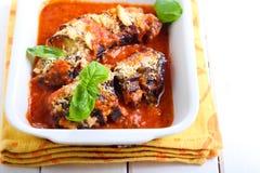 Roast aubergine parmigiana in baking tin Stock Photo