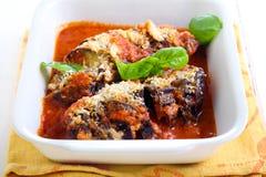 Roast aubergine parmigiana in baking tin. On table Royalty Free Stock Photos