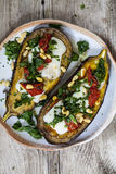 Roast aubergine on the plate Royalty Free Stock Images