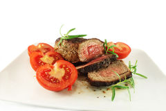 Roast beef. With tomatoes and rosemary Stock Photo