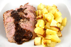 Roast beef. With potatoes, isolated in white stock images