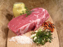 Roast beef. With herbs and garlic stock photo