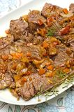 Roast beef. Tray of roast beef sliced and served with sauce Stock Photos