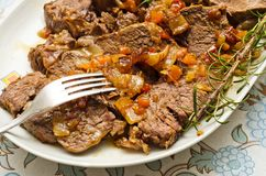 Roast beef. Tray of roast beef sliced and served with sauce Royalty Free Stock Photo