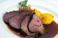 Roast beef. Served with potatoes and gravy stock images