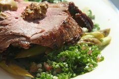 Roast beef. With garnishing on white plate royalty free stock photography