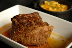Roast beef. In it own au jus with macaroni and cheese Royalty Free Stock Image
